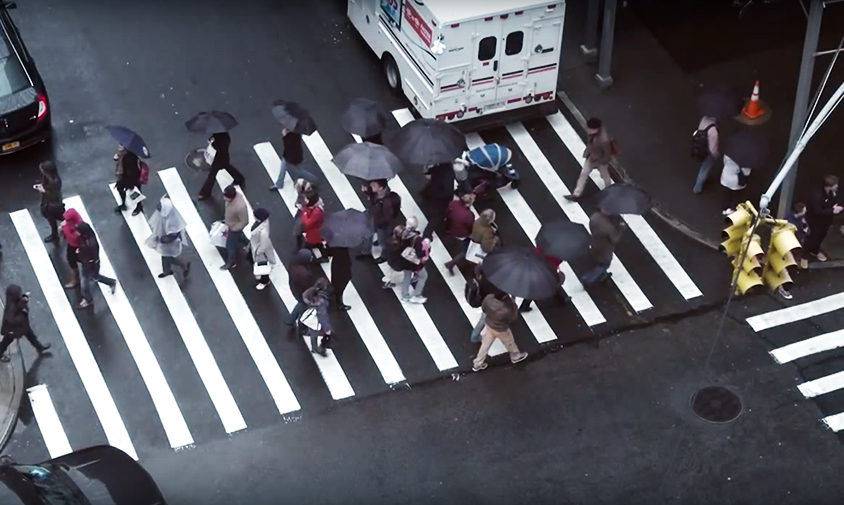 A group of people crossing the street